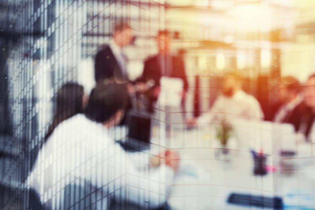 Visuel graphique d'une réunion d'affaires pour représenter le cabinet IXIS